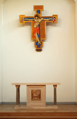 Limestone altar for Fisher House, Cambridge. The magnificent Italo-Byzantine crucifix was commissioned by the chaplaincy from the Hamilton Kerr Institute in 2005.