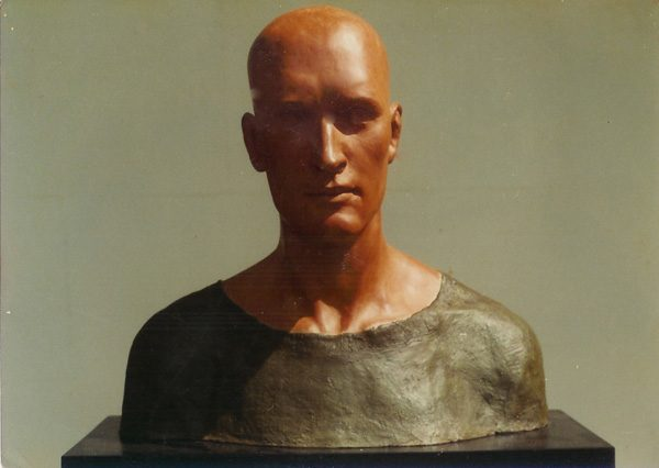 Bald man in green shirt (ceramic with cloth and cement shirt).